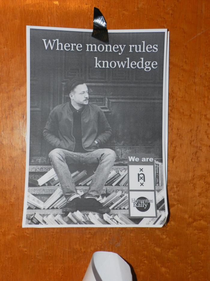 "Poster in het bezette Bungehuis: ""Where money rules knowledge""."