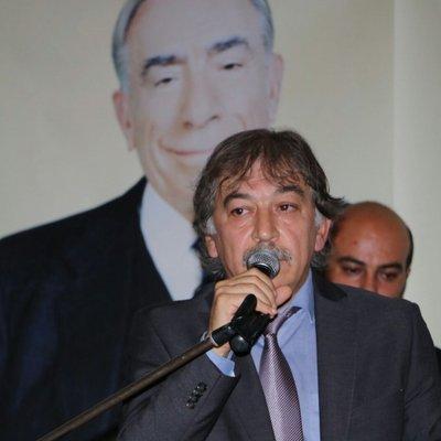 Avatar van Gunay met op de achtergrond de grote Grijze Wolven-führer Grijze Wolven Alparslan Türkeş.