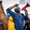 Olave Basabose in actie tijdens de Rotterdamse Pride Walk. (Foto: Dave Koster)
