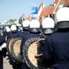 Rijen ME-ers om de demonstratie zorgden ervoor dat de spandoeken niet zichtbaar waren, en dat niemand zich kon aansluiten.